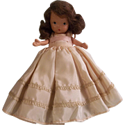 Pretty Brunette Nancy Ann Story Book Doll with Pudgy Tummy and Jointed Legs