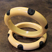 A Pair Of Polka Dot Bakelite Bangle Bracelets In Cream With Dark Green Dots, Circa 1930