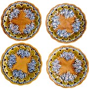 A Set Of Four Majolica Lilac Plates