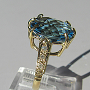 9kt Yellow Gold Vibrant Oval Blue Topaz and Diamond Artisan Ladies Ring
