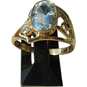 9kt Yellow Gold Oval Blue Topaz and Diamond Artisan Ladies Ring