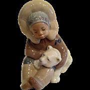 Lladro Eskimo boy and Polar Bear Cub Porcelain Figurine