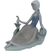 Lladro Young Girl and dove sitting figurine
