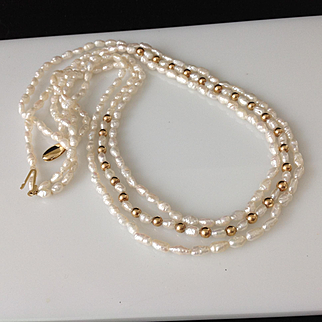 14k Gold Beads  Lustrous Fresh water Pearl Triple Strand Necklace Gold Clasp Perfect