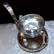 Unique South American Swinging Tea Strainer with Removable Drip Bowl in 900 Silver