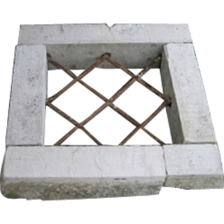Antique window stone frame with wrought iron grate