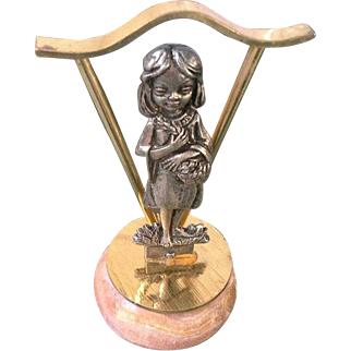 Vintage baby pewter figurine on onyx marble