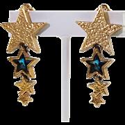 Guy Laroche Paris signed clip on Earrings Vintage goldtone blue rhinestone dangling star