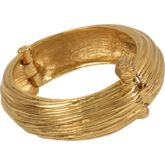Yves Saint Laurent YSL Paris Signed Clamper Bracelet vintage carved gold-tone metal