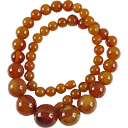 Vintage Bakelite long Necklace round beads honey amber color