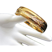 Heavy Gold Tone Bangle Bracelet with Feathered Design