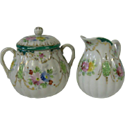 Early Japanese Export Floral Porcelain Creamer and Sugar