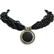 Vintage Black Seed Bead Torsade Necklace with Silver Tone Centerpiece