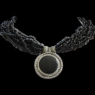 Vintage Black Seed Bead Torsade Necklace with Silver Tone Centerpiece