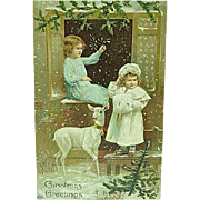 1909 Embossed Christmas Postcard By EAS Children With White Deer