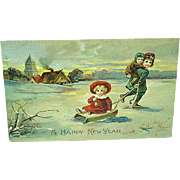 1914 Embossed New Years Postcard Children With a Sled