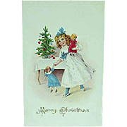 1909 Embossed Christmas Postcard Of A Girl With Her Dolls
