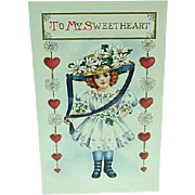 1909 Embossed Valentines Day Postcard A Girl In Her Hat Of Daisies