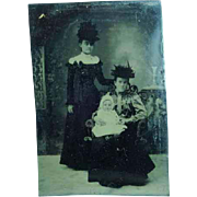 Antique 1/6th Plate Tintype of a 2 Ladies in Fancy Hats Holding a Baby