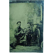 Antique 1/6th Plate Tintype of a Young Man Bone Shaker Bicycle Mug Child Bottle