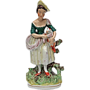 19th Century Staffordshire Pottery Figure Of A Woman With A Lamb, Circa 1850