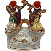 19th Century Staffordshire Pottery Group Of A Couple By A Waterfall With A Swan, Circa 1850