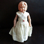 Celluloid First Aid Doll Original Dress Indian Mark