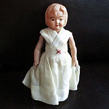 Celluloid First Aid Doll Original Dress Indian Mark
