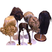 """Six Doll Wigs, size 9"""" to 12"""" C."""
