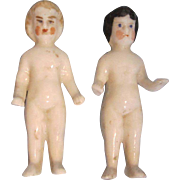 Two Antique Frozen Charlotte Dolls