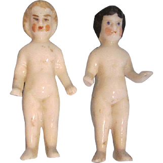 Two Antique Frozen Charlotte Dolls