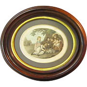 A Vintage English Print of Girls and Rabbits Mounted in a Victorian Walnut Picture Frame