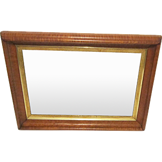 A 19th Century Curly Maple and Gilt Wood Frame Mounted with a Beveled Glass Mirror