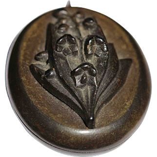 Victorian Vulcanite locket with lily of the valley front
