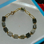 Interesting Caged stone Gold Tone Link Bracelet