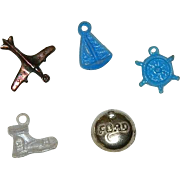 Collection of 5 Early Celluloid Cracker Jack Charms of Transportation Theme