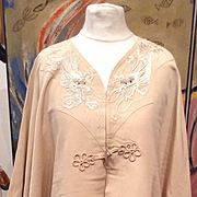 Edwardian silk coat embroidered with dragons in silk. Circa 1900