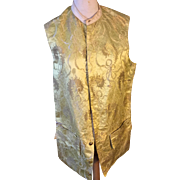 18 th century men's waistcoat altered for theatre in the 19 th century. Golden yellow brocade with feather motif.
