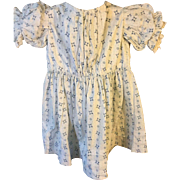 1860's cotton dress. Small child's , made from earlier fabric. White cotton with indigo pattern.