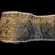 3 meters of early 19 th century Italian metallic braid. Gold metallic weave.