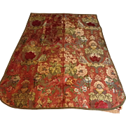 Early 18 th century silk bricade featuring a lady, a cherub , musical instruments. Claret red silk brocade. English