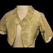 Georgian . Circa 1800 .ladies silk spencer or top. Pale olive green.