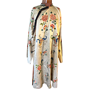 19 th century Chinese robe. Beautiful embroidered bats , butterflies and flowers. Ivory silk. Long .