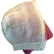 Early 19 th century knitted babies bonnet. English. Skillful knitting.
