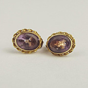 Pair Of 9ct Yellow Gold Amethyst Stud Earrings
