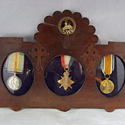 1914/15 South Wales Borderers Medals In Period Frame With Cap Badge
