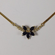 18 Ct Yellow Gold 0.10 CTW Diamond and 0.50 CTW Sapphire Necklace