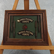 WW1 Framed RFC Set Of Shoulder Signs, Cap Badge & Flechettes