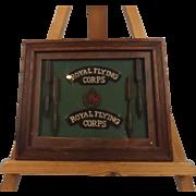 WW1 Framed RFC Set Of Shoulder Signs, Cap Badge & Flechettes