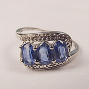 10 Ct Yellow Gold Thee Stone Crossover Tanzanite Ring UK Size P ½ US Size 8